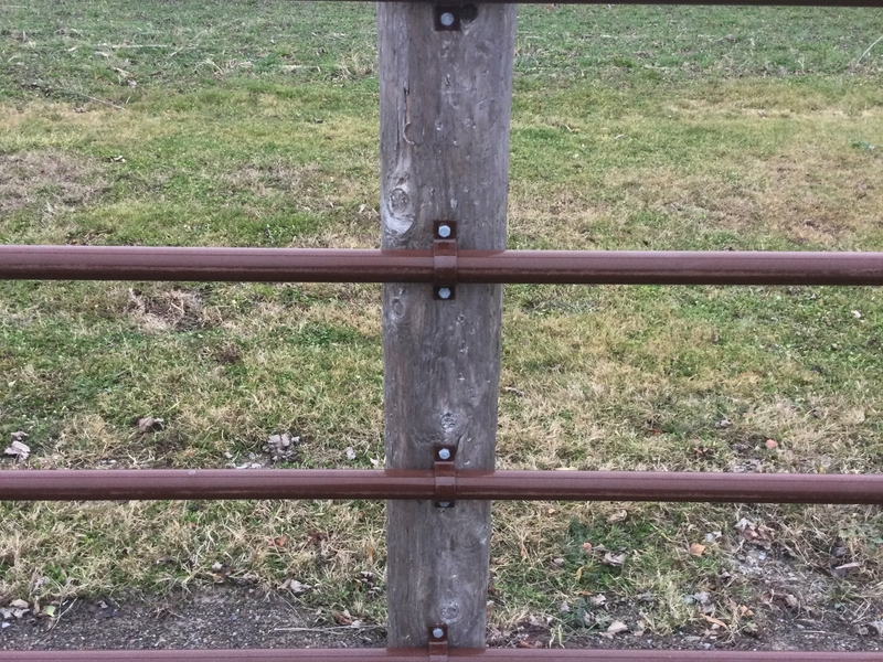 Continuous Fence clips installed on a fence post
