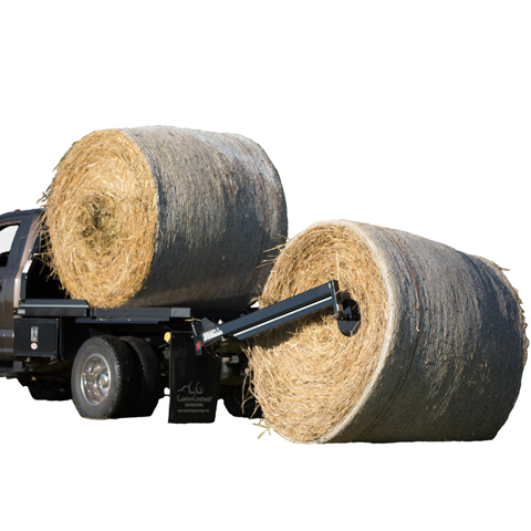 A Bale Bed unloading bales